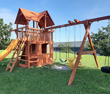 Woodplay square base playset installed in Davie, Florida by Play King.